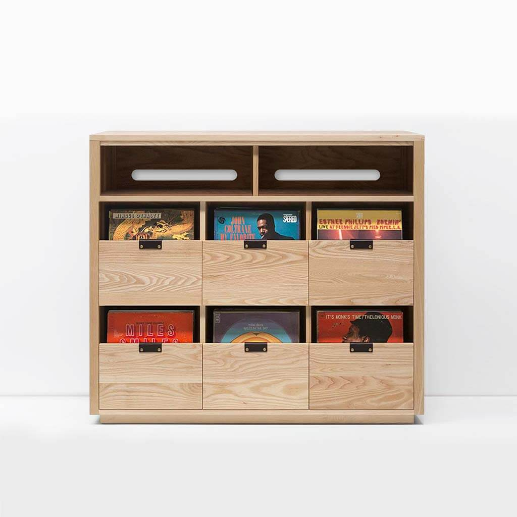 Dovetail 3 X 2.5 Vinyl Storage Cabinet with light yellow-hued natural ash finish displaying LP storage. Features an equipment shelf with passive ventilation and cable management for audio equipment storage and access. Includes dovetail drawer boxes with full extension soft-close under-mount slides and can fit 540 vinyl records.