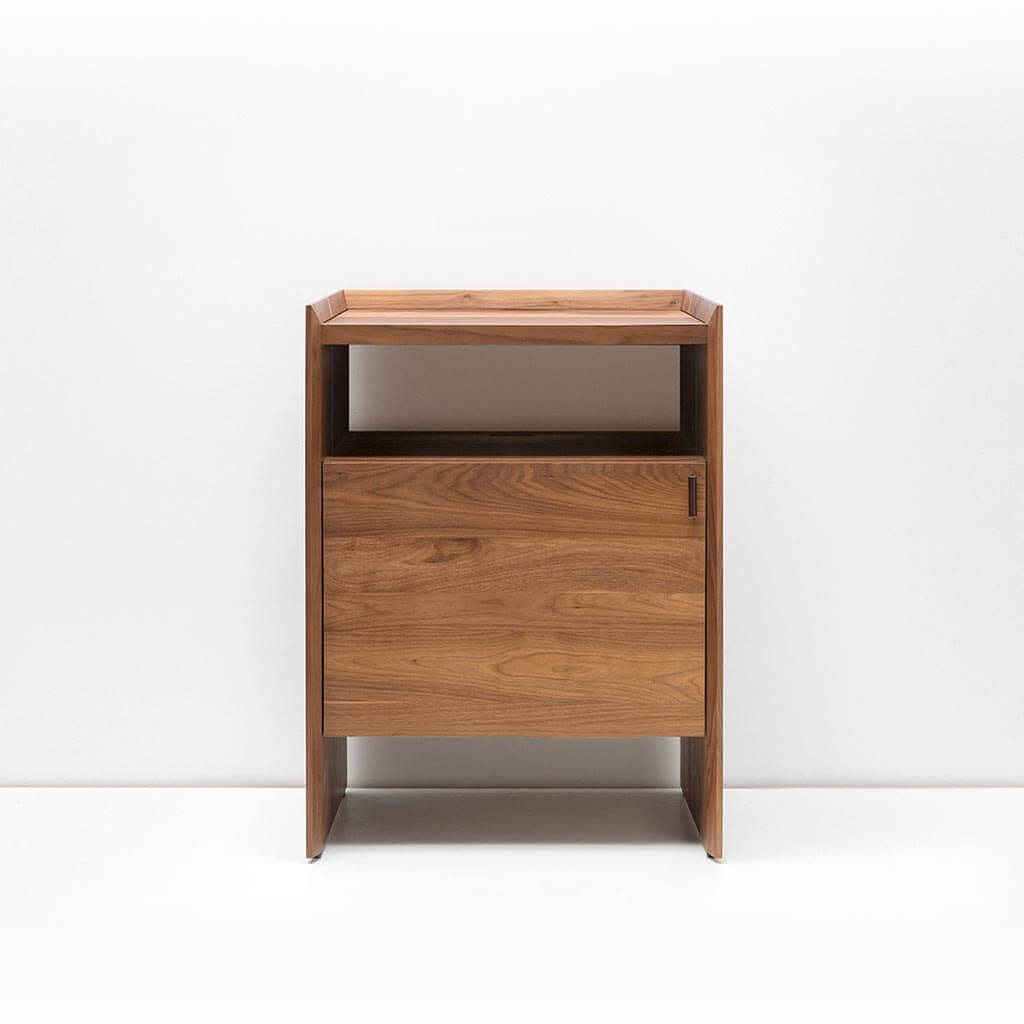 Unison Walnut Record Stand with flip-style LP storage bins, vibration isolated record player platform, and audio cabinet room for hi-fi sound equipment. Features a dark natural walnut wood finish.