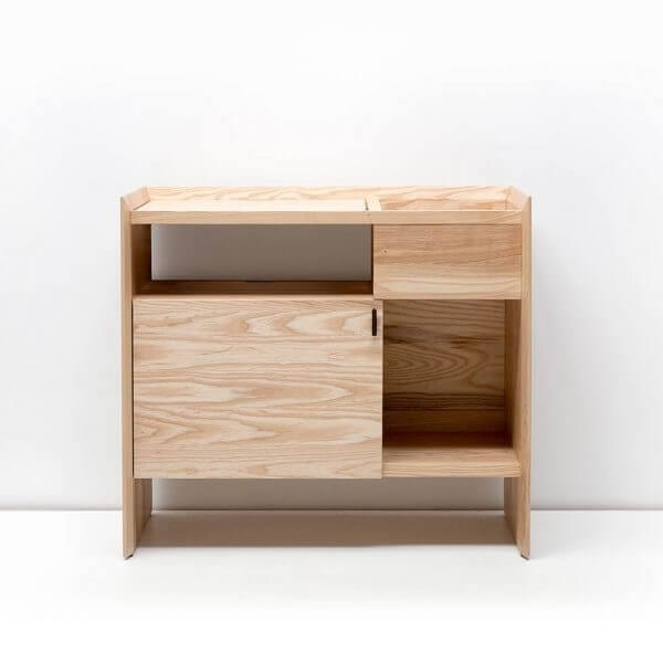 Unison Record Storage Stand with flip-style LP storage bins, vibration isolated record player platform, and audio cabinet room for hi-fi sound equipment with a light ash finish. Crafted from premium North American hardwoods and displayed with open drawers and empty storage spots.