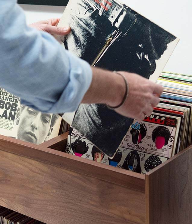 Unison Vinyl Storage Cabinet with flip-style LP storage bins and room for 330 LPs. Convenient flip-style LP storage access. Crafted from premium North American hardwoods and focused on premium vinyl storage.
